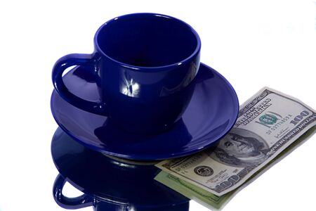 american dollars and kazakhstan tenge with blue cup photo