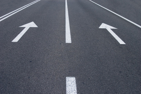 the road surface: photo of road signs arrows on asphalted surface