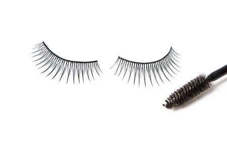 artificial eyelashes isolated over white photo