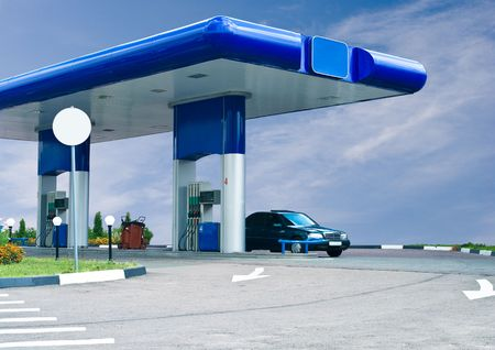 gas refuel station against cloudy sky photo