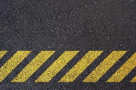 Under construction symbol on dark asphalt surface photo