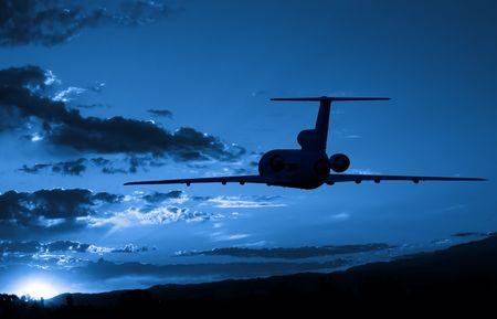 Aeroplane flying to sunrise photo