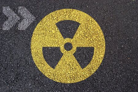 Nuclear warning symbol on asphalt surface Stock Photo - 2711062