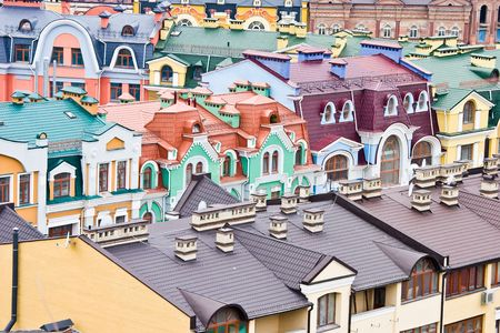 rooftiles: Abstract multicolored urban roofs Stock Photo
