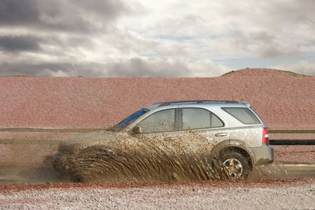 Off road car forces water photo