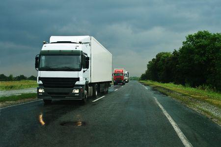 Group of trucks on wet asphalt after rain Stock Photo - 3666555