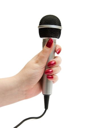 Dynamic silver microphone isolated over white background photo