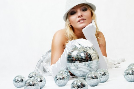Attractive young beautiful woman with disco balls Stock Photo