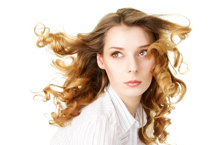 Attractive woman with fly-away hair isolated over white background Stock Photo - 4089350