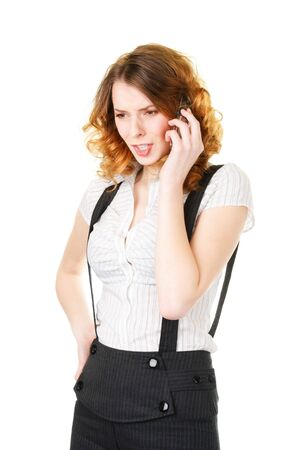 Angry young woman talking by mobile phone photo