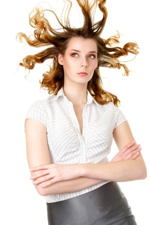 Attractive woman with fly-away hair isolated over white background photo