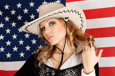 Young blonde girl over american flag portrait photo