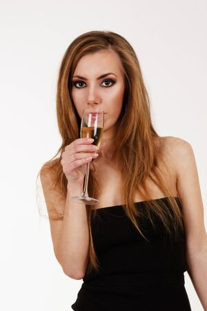 Young woman with glass of champagne photo