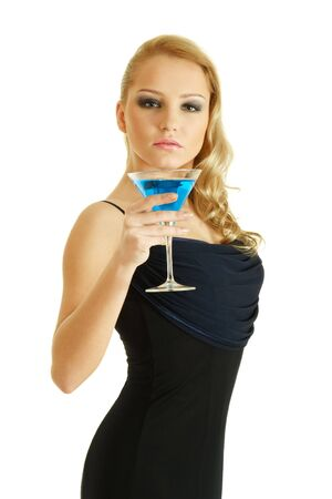 Young blonde woman with blue cocktail isolated over white background photo