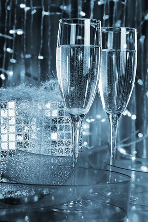 romantics: Two glasses with champagne and christmas decorations