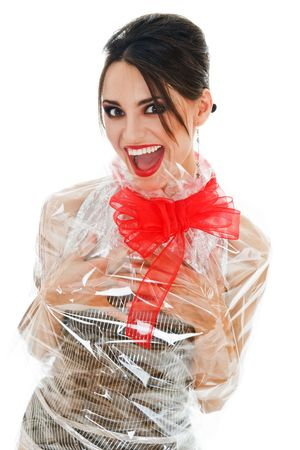 Sexy woman wrapped into wrapping paper like gift with red bow Stock Photo - 5290576