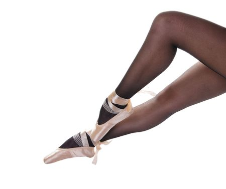Sexy ballerines legs in pointes isolated over white background