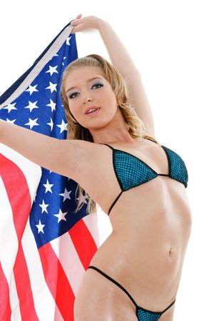 Sexy girl with american flag isolated over white background photo