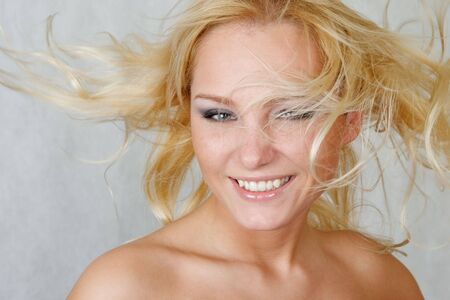 flyaway: Attractive woman with fly-away blonde hair Stock Photo