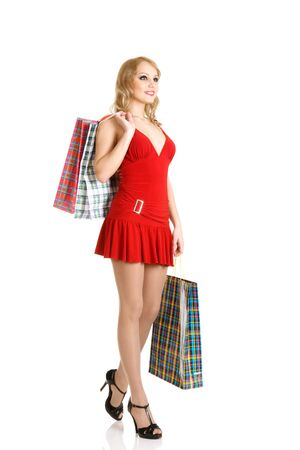 Blonde fashion model in red mini dress at shopping isolated over white background photo