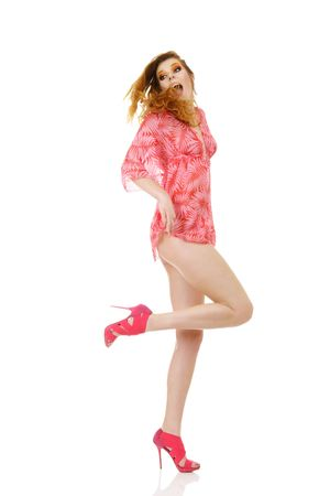 Sexy fashion model in pink mini dress with long legs photo