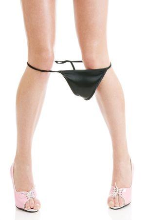 pantalones abajo: Sexy mujer derribar bragas aisladas sobre fondo blanco Foto de archivo