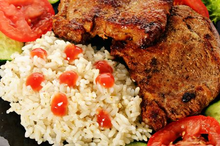 Fried beef meat steaks with vegetable garnish photo