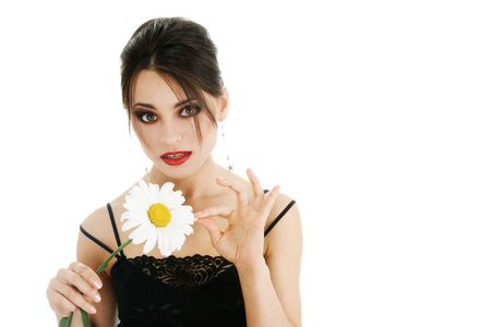 Beautiful young woman with daisy flower photo