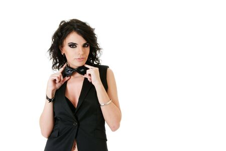 Sexy young woman in black waistcoat isolated over white background photo