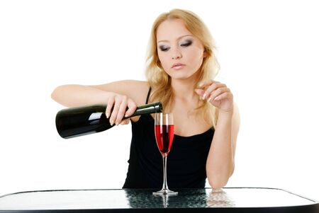 Blonde woman and red wine isolated over white photo