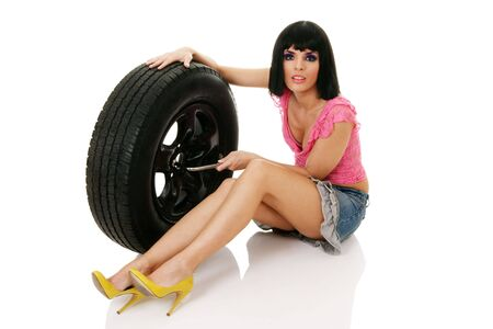 Woman and wheel isolated over white background photo