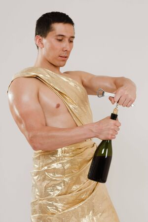 Man weared in ancient costume opening bottle of wine photo