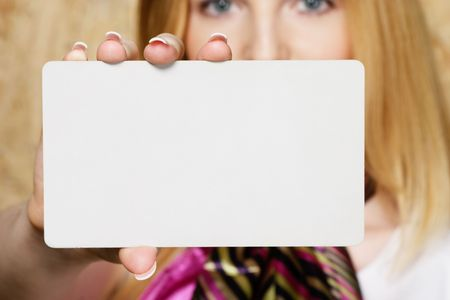 businesscard: Young businesswoman holding businesscard Stock Photo
