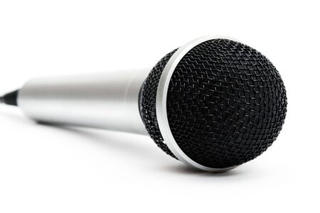 Dynamic silver microphone isolated over white background Stock Photo - 6432540