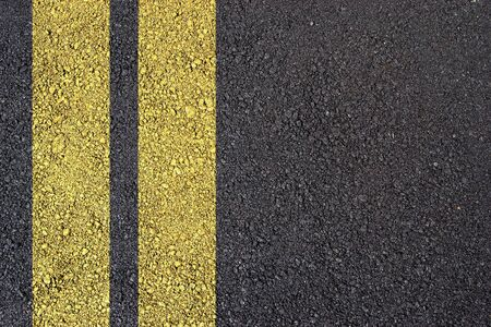 Dark asphalt surface with yellow line photo