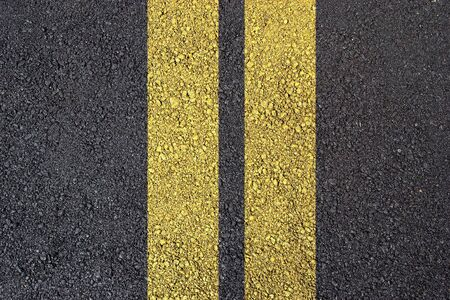 Dark asphalt surface photo with yellow line Stock Photo - 6485558