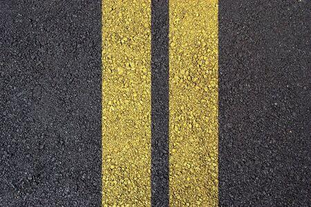 yellow line: Dark asphalt surface photo with yellow line