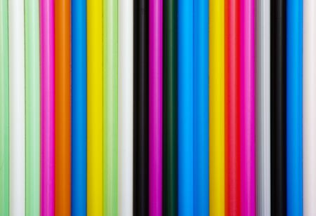 Abstract texture with multicolored cocktails drinking straws photo