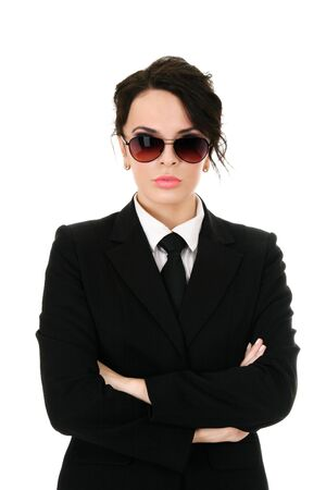 Serious businesswoman in black glasses isolated on white background photo