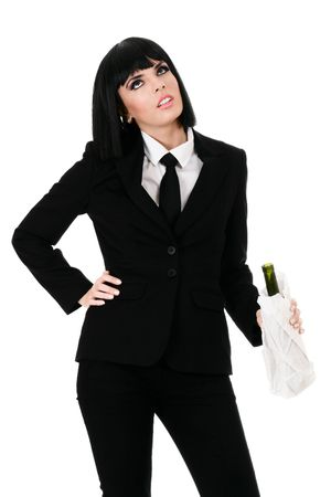 Drunken businesswoman with bottle wrapped in paper parcel isolated on white background photo