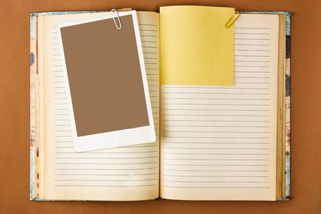 Old notebook with stained pages on brown paper surface. Useful for web site template Stock Photo - 6612986
