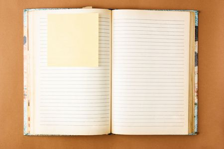 old notebook: Old notebook with stained pages on brown paper surface. Useful for web site template