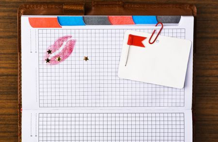 Tabbed notebook with colored tabs and red lips print. Useful for web site template photo