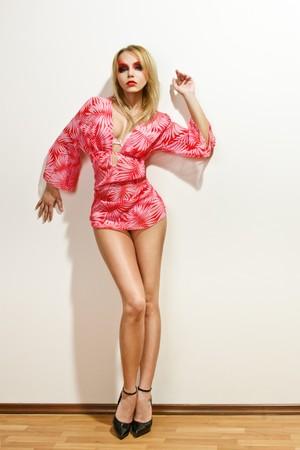 Sexy fashion model posing near wall Stock Photo - 7833230