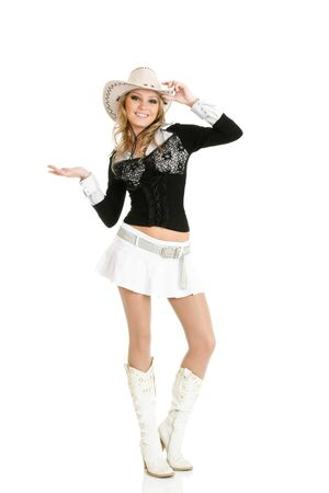 Young cowgirl woman dancing isolated over white photo