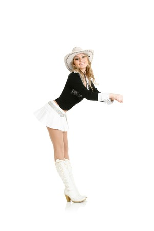 sexy skirt: Young cowgirl woman dancing isolated over white