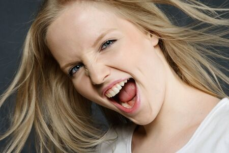 Happy surprised screaming young woman emotional portrait Stock Photo - 7985973