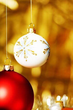 Christmas ball over golden backgrounds photo