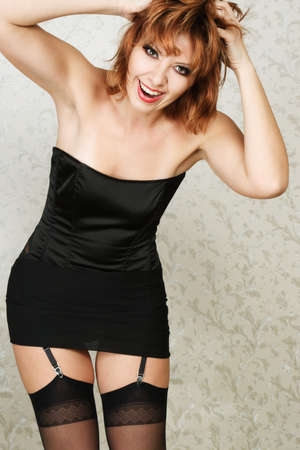 Happy young sexy woman dressed in black lingerie photo