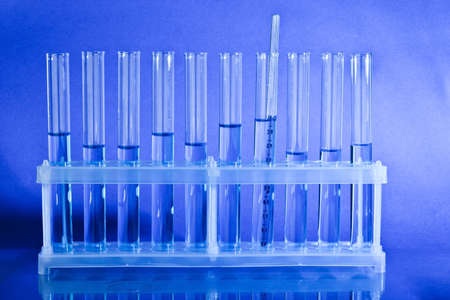 test tubes: Test tubes with liquid over blue background
